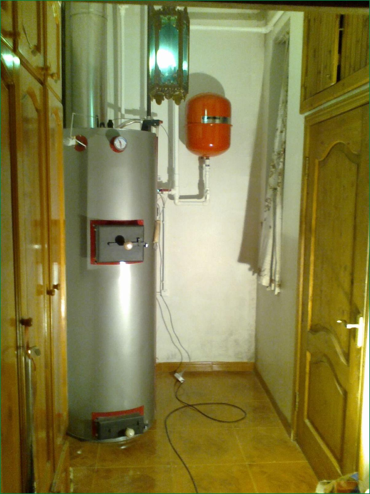 Отопление частного дома на твердом топливе: котлы и печи 57